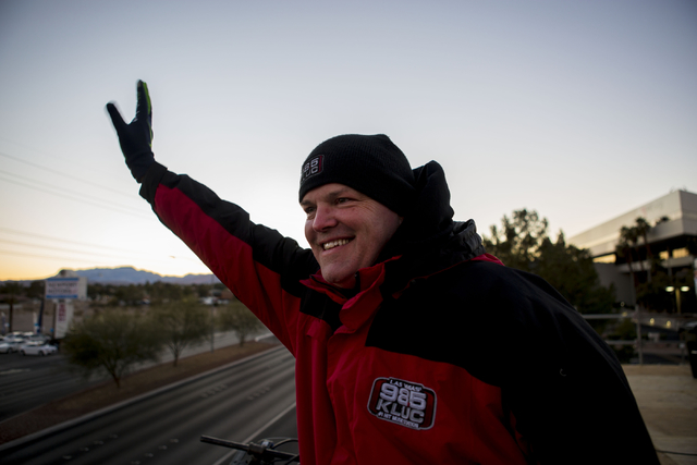 Chet Buchanan, host of 98.5 KLUC's Chet Buchanan and the Morning Zoo, waves to traffic below his 20-foot tall scaffolding at NV Energy, 6226 W. Sahara Avenue, where his continues to host his show  ...