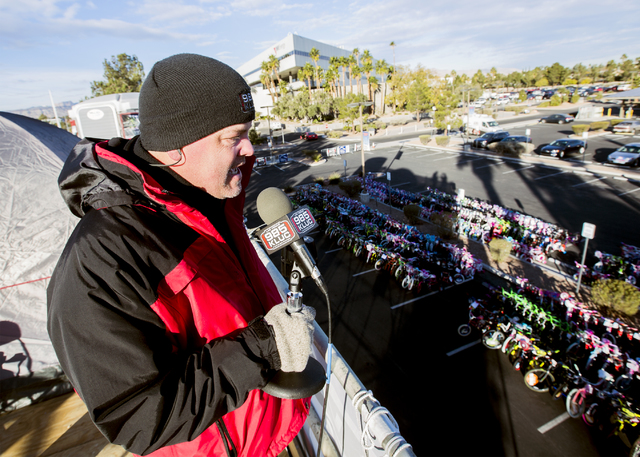Chet Buchanan, host at 98.5 KLUC, broadcasts live while a parking lot fills up with donated bicycles during the 18th Annual Chet Buchanan & The Morning Zoo Toy Drive on Thursday, Dec. 08, 2016 ...