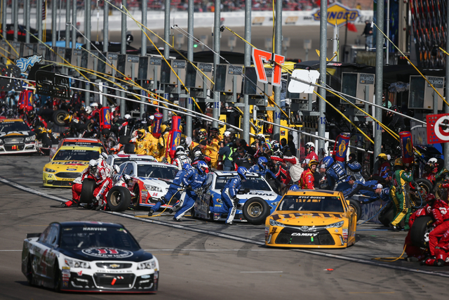 Cars make pit stops during the NASCAR Sprint Cup Series Kobalt 400 race at the Las Vegas Motor Speedway in Las Vegas on Sunday, March 6, 2016. Chase Stevens/Las Vegas Review-Journal Follow @csstev ...