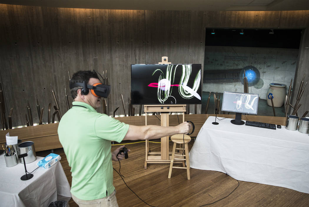 """Assistant management analyst Mike Weintz demonstrates Springs Preserve's new """"Paint on Air"""" virtual reality experience on Wednesday, February 21, 2018, in Las Vegas. Benjamin Hager Las V ..."""