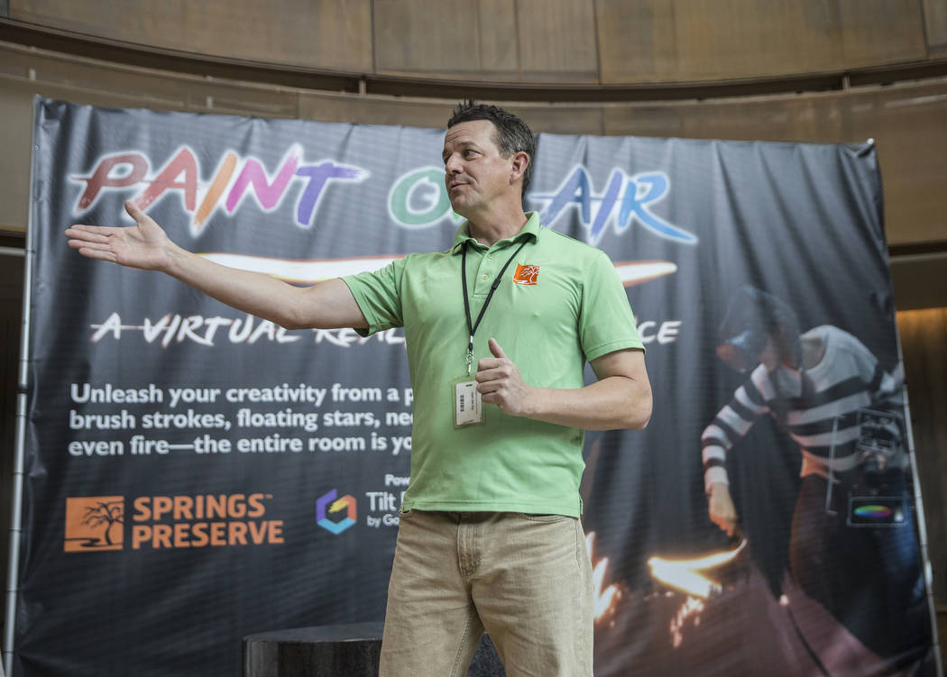 """Assistant management analyst Mike Weintz discusses Springs Preserve's new """"Paint on Air"""" virtual reality experience on Wednesday, February 21, 2018, in Las Vegas. Benjamin Hager Las Vega ..."""
