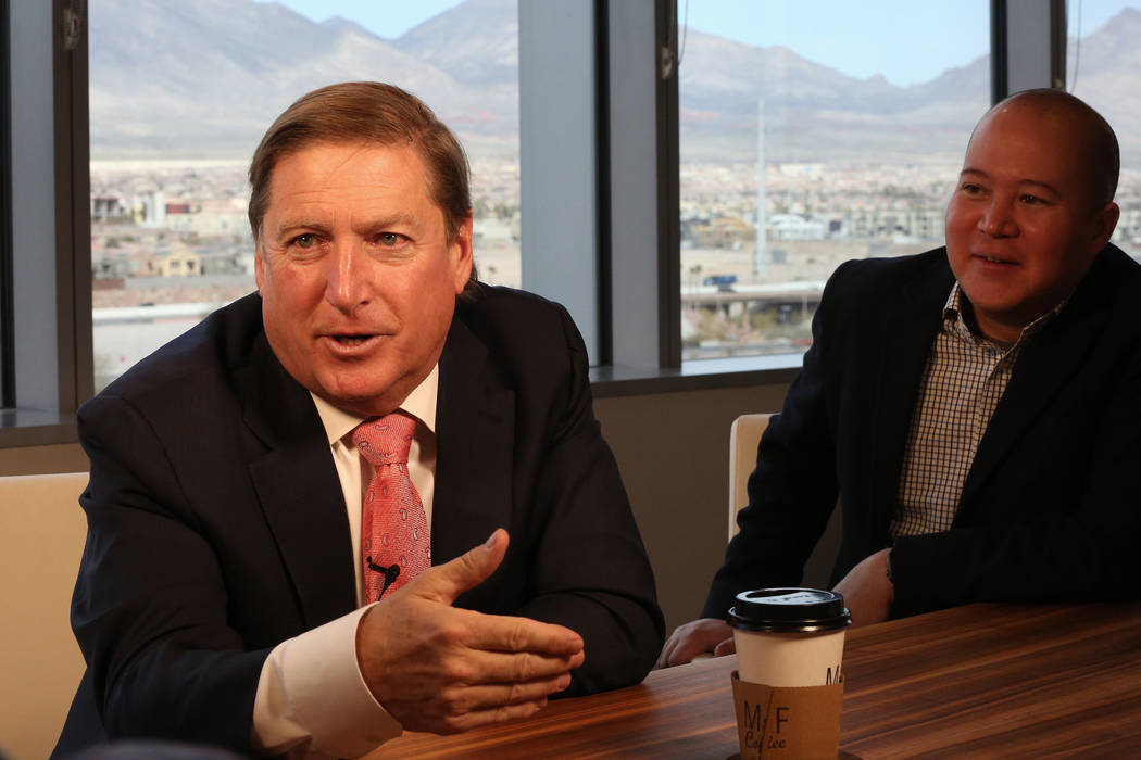 Senior Vice President of Full House Resorts Lewis Fanger, right, listens as Dan Lee, CEO of Full House Resorts, discusses investments the company has made in casinos outside of Nevada at their off ...