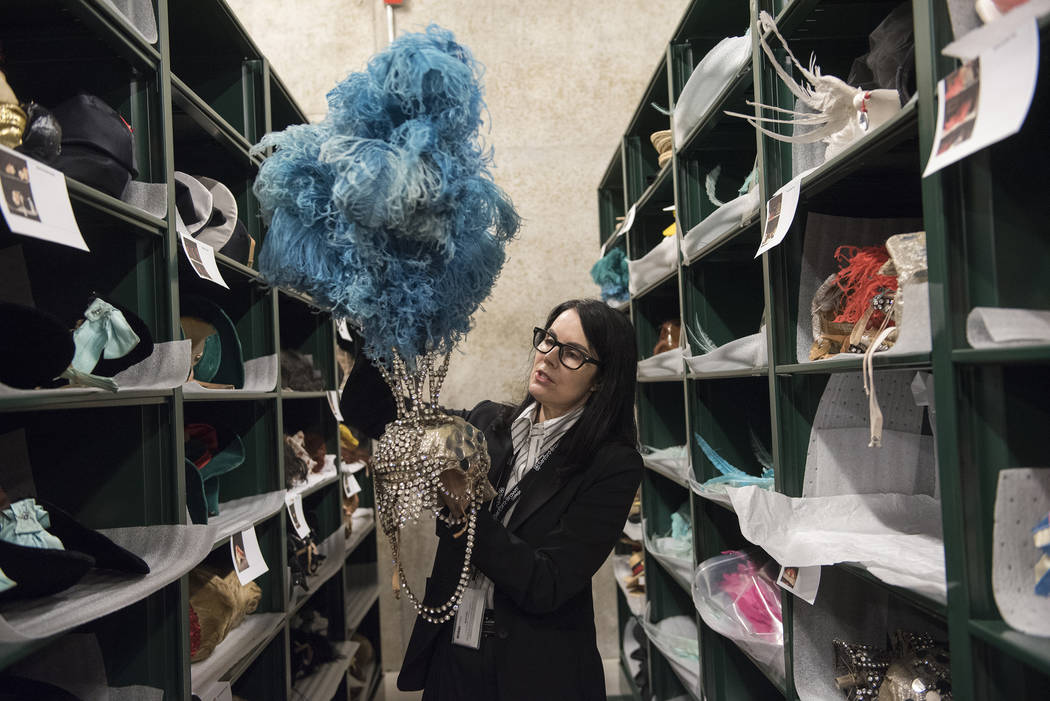 Karan Feder, guest curator of costume and textiles, holds a head dress from the Les Folies Bergere exhibit at the Nevada State Museum in Las Vegas on Saturday, Aug. 27, 2016.  Martin S. Fuentes/La ...