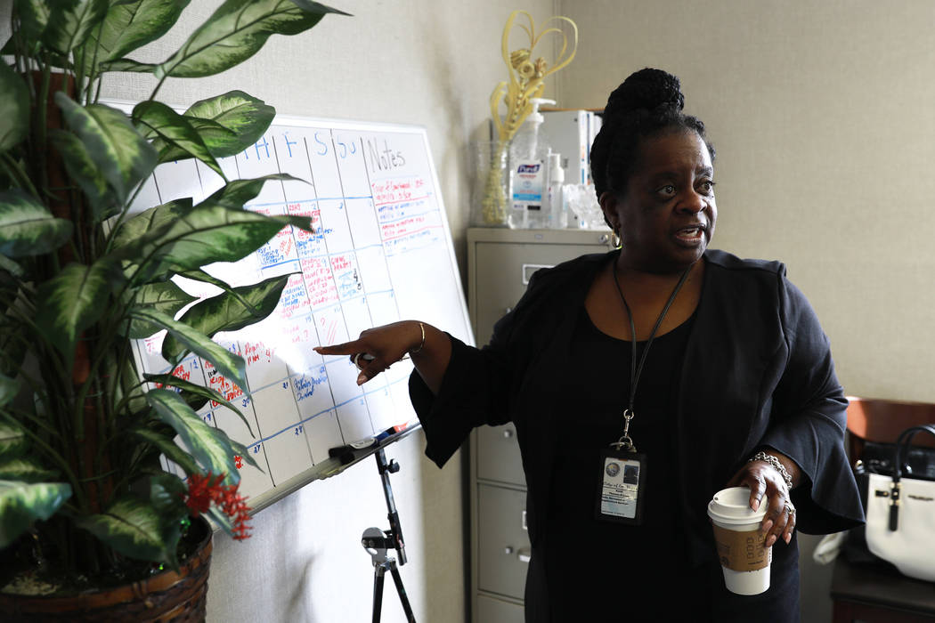 Kathi Thomas-Gibson talks about the services provided at a courtyard for the city's homeless population off of Las Vegas Boulevard and Foremaster Lane in Las Vegas on Thursday, March 1, 2018. Andr ...