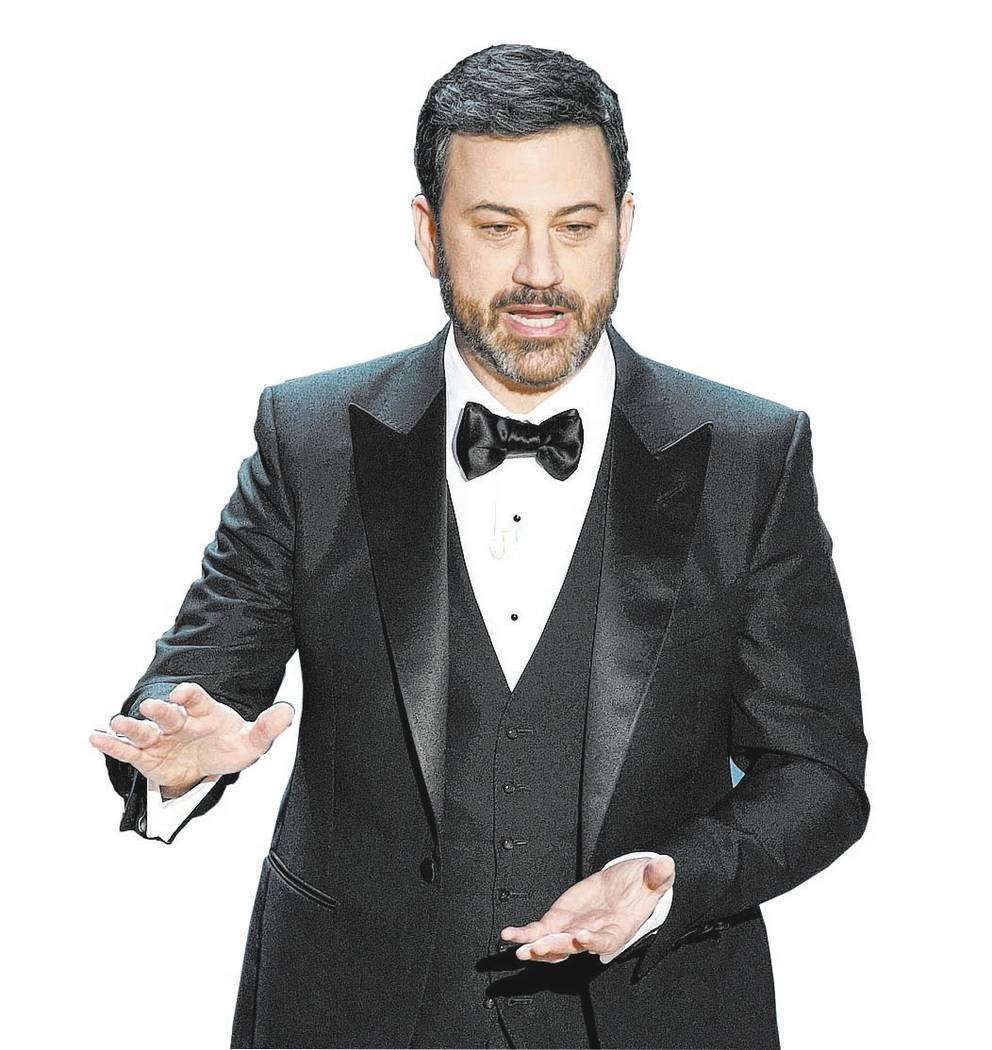 FILE - In this Feb. 26, 2017, file photo, host Jimmy Kimmel appears at the Oscars in Los Angeles. Kimmel accepted U.S. Senate candidate Roy Moore's invitation to meet him in Alabama on Nov. 30, 20 ...