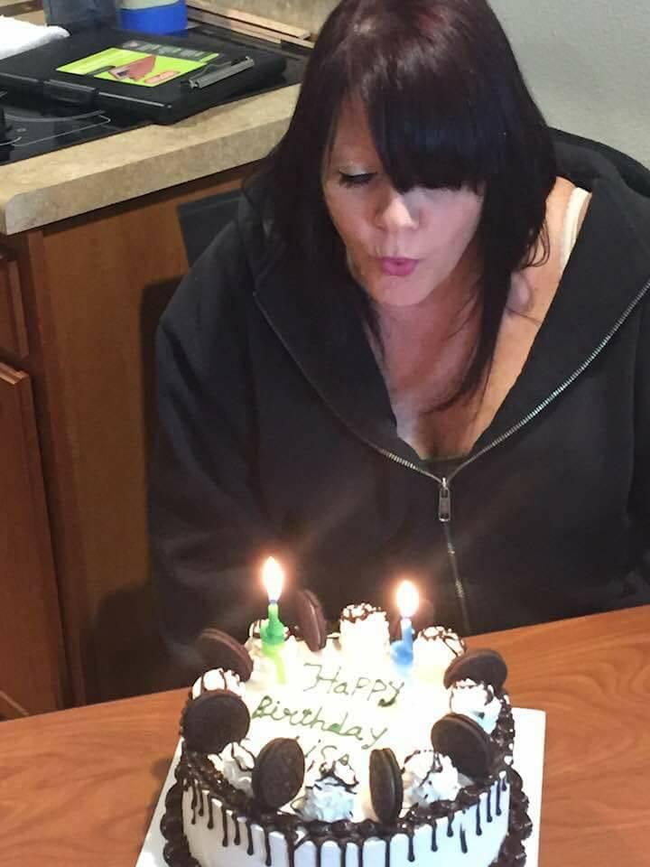 Lisa Gori blows out candles on a birthday cake. (Courtesy Steve Gori)