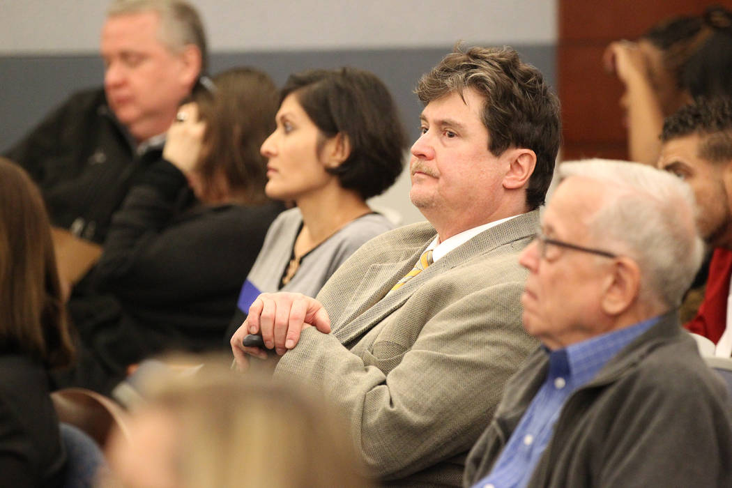 Mark Georgantas, second from right, who persuaded people to give him money for what prosecutors said was a casino scam, waits to be sentenced at the Regional Justice Center in Las Vegas on Feb. 26 ...