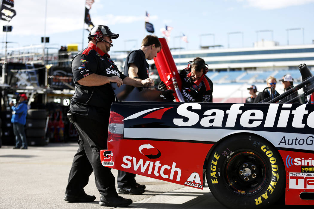 Members of Noah Gragson's (18) pit crew work on his vehicle during practice ahead of the NASCAR Camping World Truck Series, slated for Friday, at the Las Vegas Motor Speedway in Las Vegas on Thurs ...