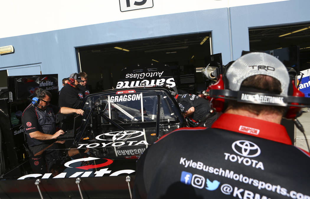 Member's of Noah Gragson's (18) pit crew during practice ahead of the NASCAR Camping World Truck Series, slated for Friday, at the Las Vegas Motor Speedway in Las Vegas on Thursday, March 1, 2018. ...