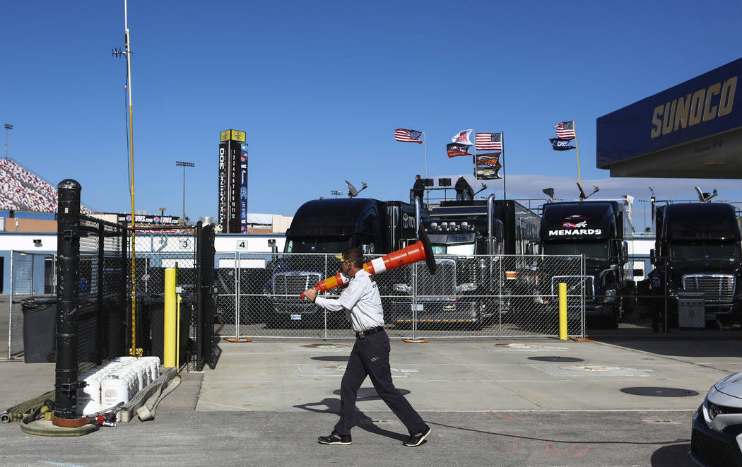 A track employee moves a traffic cone during practice ahead of the NASCAR Camping World Truck Series, slated for Friday, at the Las Vegas Motor Speedway in Las Vegas on Thursday, March 1, 2018. Ch ...