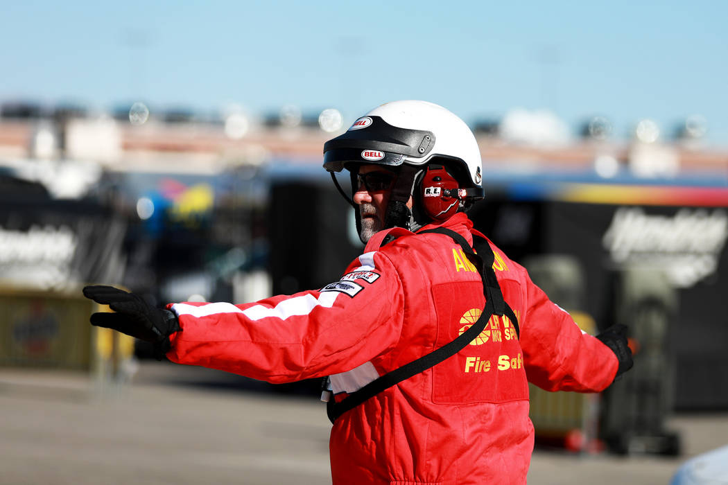 An employee directs the way for the NASCAR Camping World Truck Series Qualifier at the Las Vegas Motor Speedway in Las Vegas on Friday, March 2, 2018. Andrea Cornejo Las Vegas Review-Journal @Drea ...
