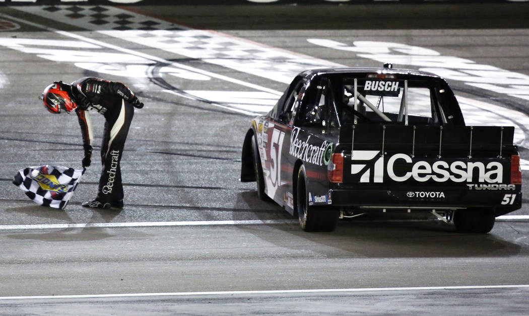 Kyle Busch (51) celebrates after winning his 50th career Camping World Truck Series race at the Las Vegas Motor Speedway in Las Vegas on Friday, March 2, 2018. Andrea Cornejo Las Vegas Review-Jour ...