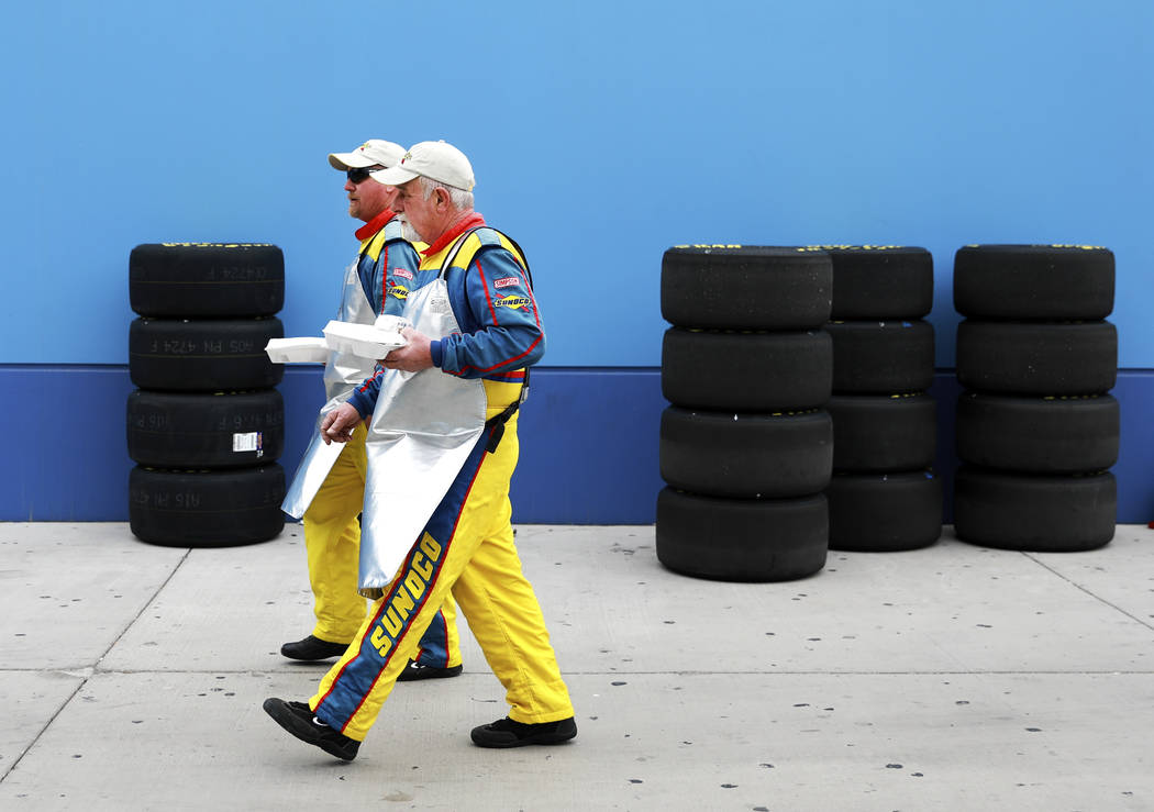 Men walk past rows of tires before the NASCAR  Xfinity Series Boyd Gaming 300 auto race at the Las Vegas Motor Speedway in Las Vegas on Saturday, March 3, 2018. Andrea Cornejo Las Vegas Review-Jou ...