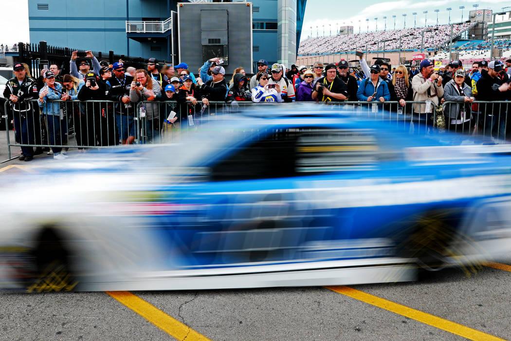 Attendees watch cars return to the Neon Garage at the Las Vegas Motor Speedway in Las Vegas on Saturday, March 3, 2018. Andrea Cornejo Las Vegas Review-Journal @DreaCornejo