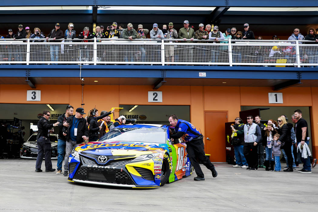 Attendees watch as Kyle Busch's (18) pit crew prepare for a practice run at the Las Vegas Motor Speedway in Las Vegas on Saturday, March 3, 2018. Andrea Cornejo Las Vegas Review-Journal @DreaCornejo