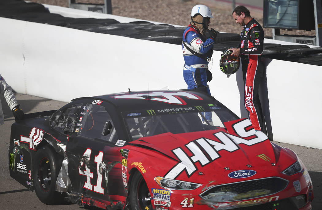Race officials check on Kurt Busch (41) after he crashed into Chase Elliott (9) during the Monster Energy NASCAR Cup Series Pennzoil 400 auto race at the Las Vegas Motor Speedway in Las Vegas on S ...