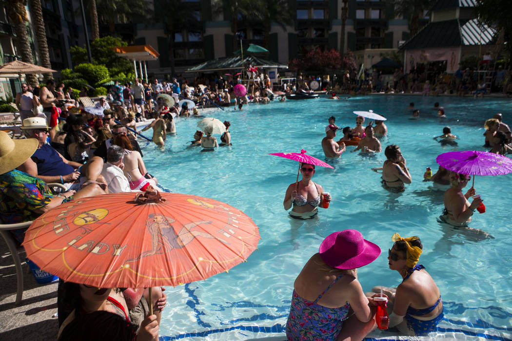 Attendees relax by the pool during the final day of the Viva Las Vegas Rockabilly Weekend at The Orleans hotel-casino in Las Vegas on Sunday, April 16, 2017. Chase Stevens Las Vegas Review-Journal ...