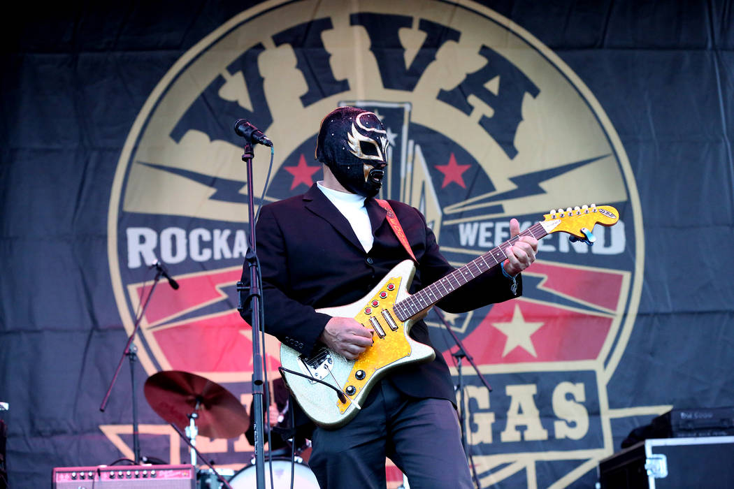 Eddie Angel of Los Straitjackets dishes out surftastic tones on his DiPinto Galaxie 4 guitar at the Viva Las Vegas Rockabilly Weekender car show at the Orleans on Saturday, April 15, 2017. Michael ...