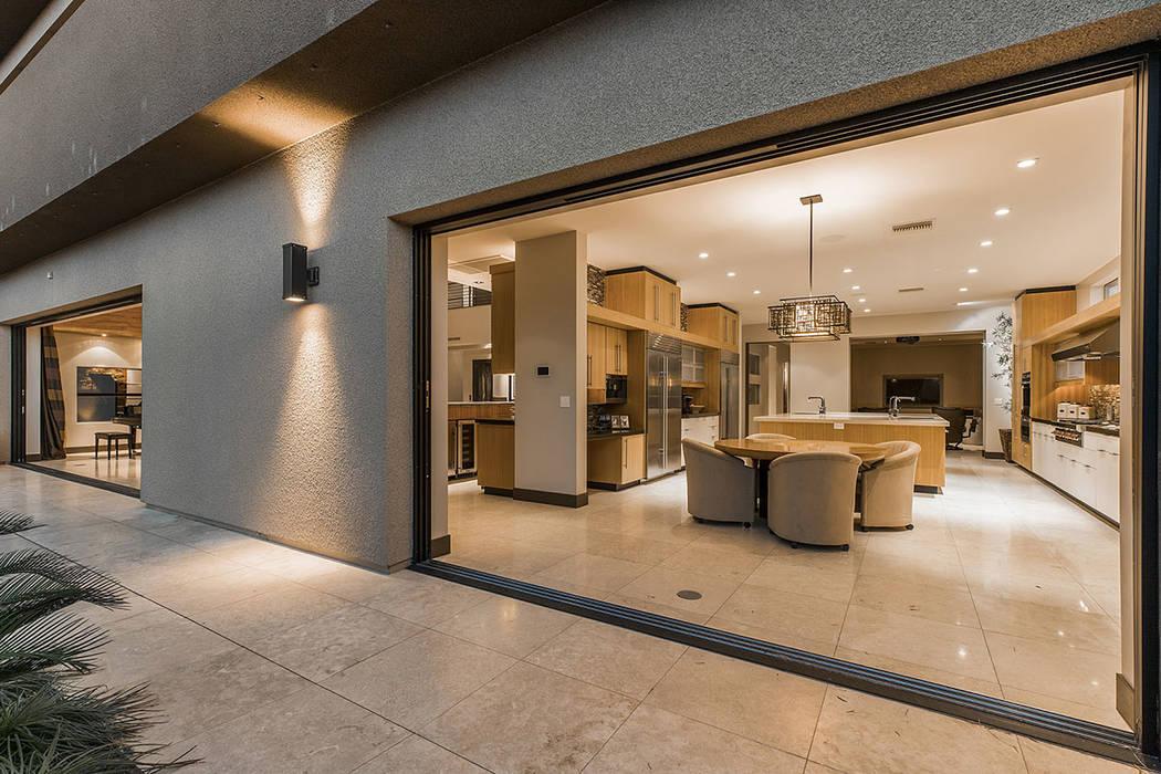 Large pocket doors open to the backyard. (Shapiro & Sher Group)