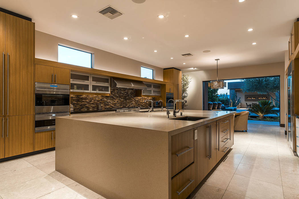 The kitchen opens to the backyard. (Shapiro & Sher Group)
