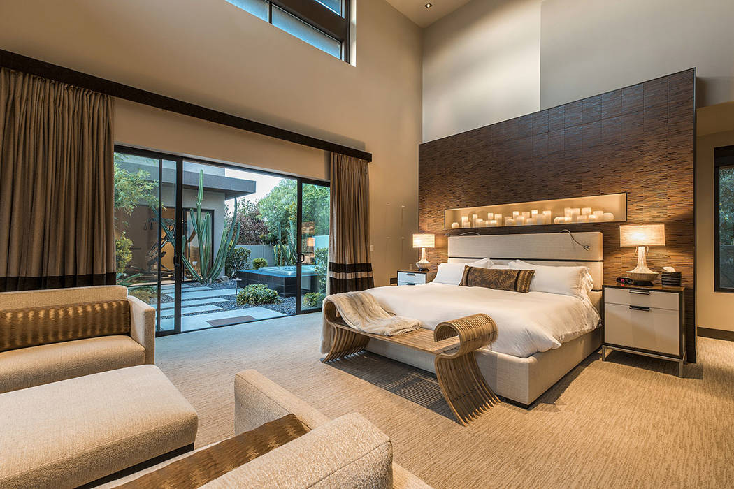 The downstairs master suite opens to the pool area.  (Shapiro & Sher Group)