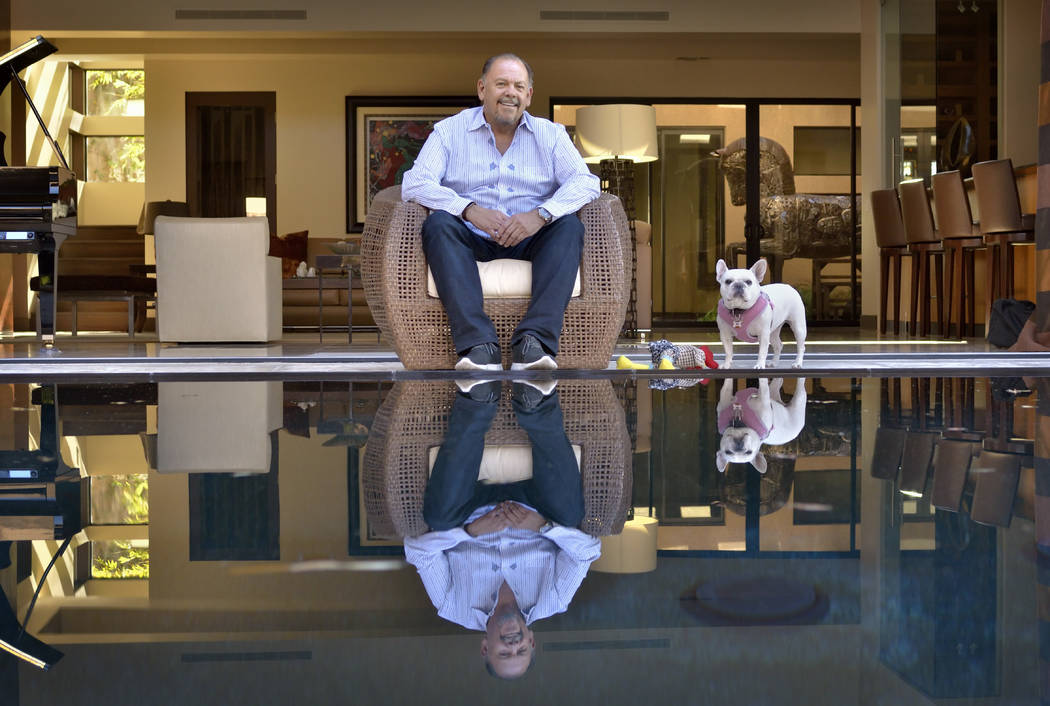 Craig Moe is shown with his dog Lucy at his Blue Heron home at 6671 Tomiyasu Lane. It's listed for $3.775 million. He plans to build a custom home in Ascaya. (Bill Hughes Real Estate Millions)