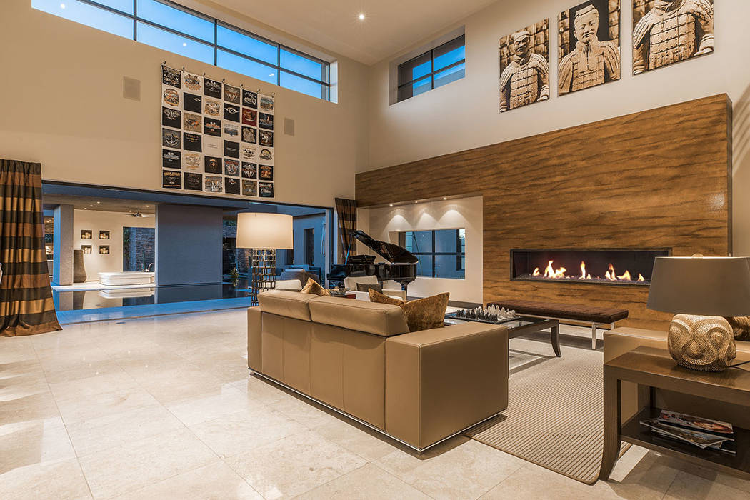 The living room opens to the pool area.  (Shapiro & Sher Group)