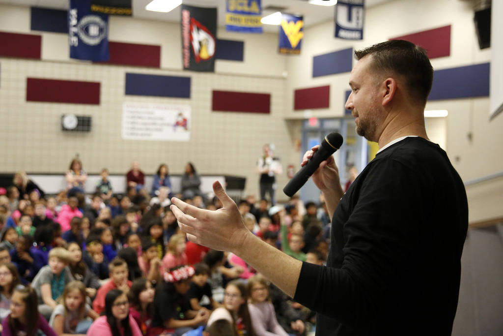 Chad Trisef, author of the Oracle Series, talks about his books in order to promote literacy for Nevada Reading Week at Harriet Treem Elementary School in Henderson on Monday, Feb. 26, 2018. Andre ...