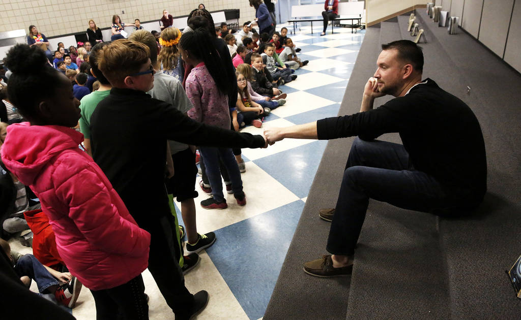 Chad Trisef, author of the Oracle Series, greets students before talking to them about his books for Nevada Reading Week at Harriet Treem Elementary School in Henderson on Monday, Feb. 26, 2018. A ...