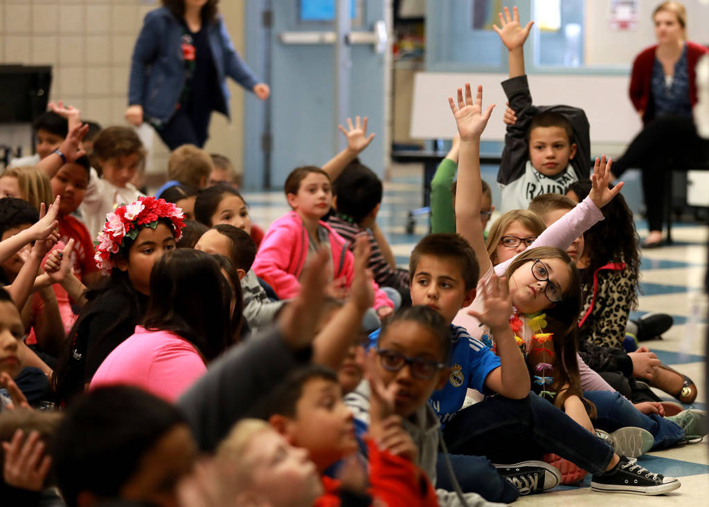 Students attend a school assembly for Chad Trisef, author of the Oracle Series, during Nevada Reading Week at Harriet Treem Elementary School in Henderson on Monday, Feb. 26, 2018. Andrea Cornejo  ...