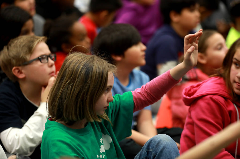 Natalie Adams, 11, raises her hand to ask Chad Trisef, author of the Oracle Series, a question about his books during Nevada Reading Week at Harriet Treem Elementary School in Henderson on Monday, ...