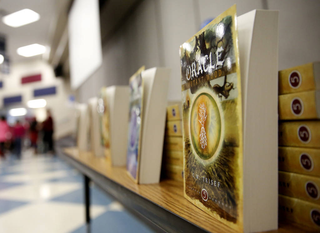 Chad Trisef's Oracle Series are placed on display during Nevada Reading Week at Harriet Treem Elementary School in Henderson on Monday, Feb. 26, 2018. Andrea Cornejo Las Vegas Review-Journal @Drea ...