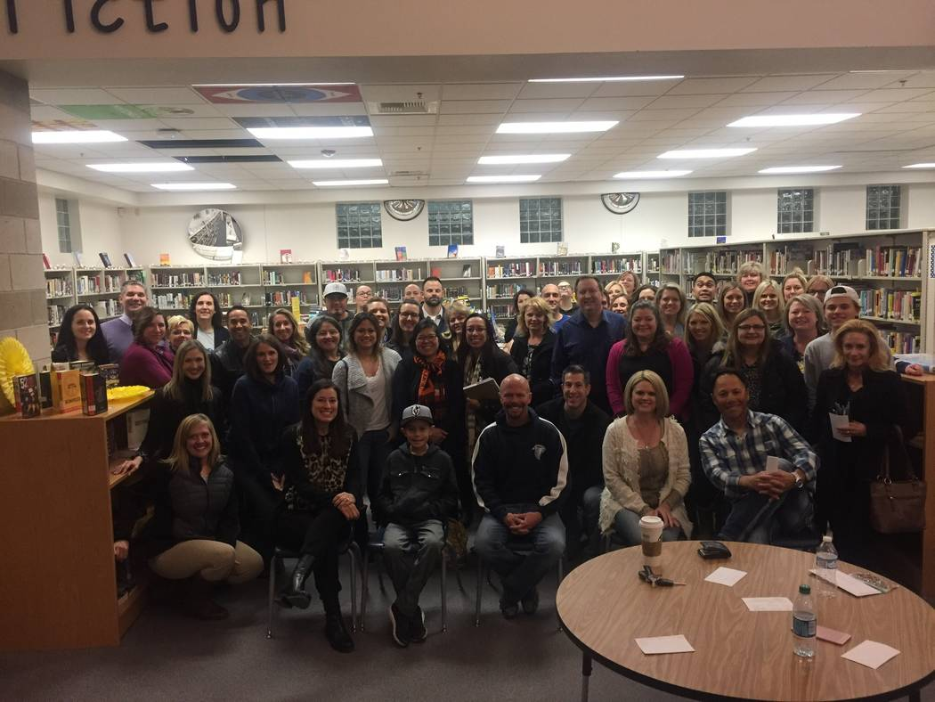 """Attendees poses for a photo at Foothill High School in Henderson, Wednesday, Feb. 21, 2018, during a meeting to discuss certain """"core values"""" they think students should have. (Megan Delaney/La ..."""