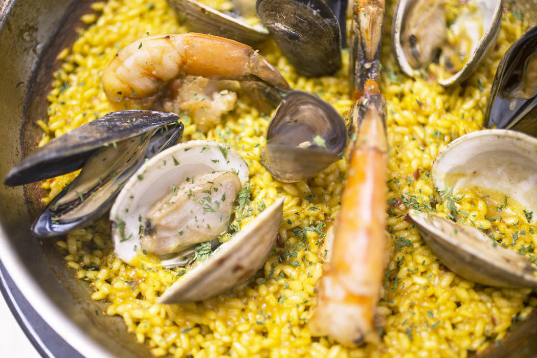 Seafood paella with shrimp, langoustines, cuttlefish, squid, seafood broth, bomba rice and saffron at Kitchen Table Squared on Thursday, March 1, 2018, in Las Vegas. Benjamin Hager Las Vegas Revie ...