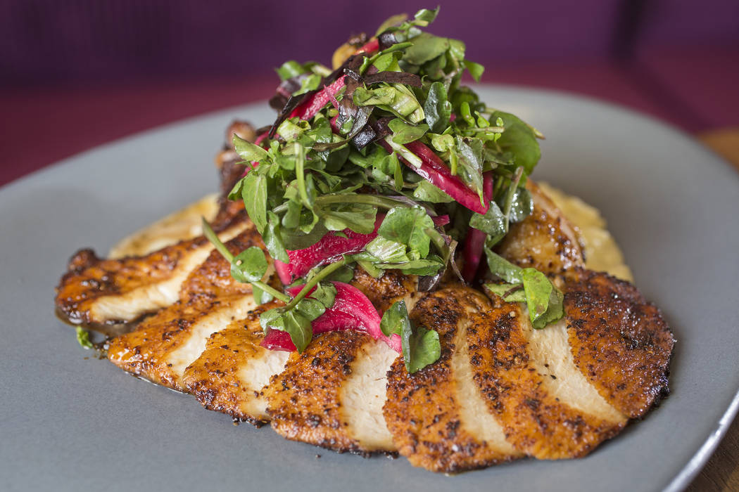 Chile rubbed half chicken with cilantro lime butter and roasted cauliflower au gratin at Kitchen Table Squared on Thursday, March 1, 2018, in Las Vegas. Benjamin Hager Las Vegas Review-Journal @be ...