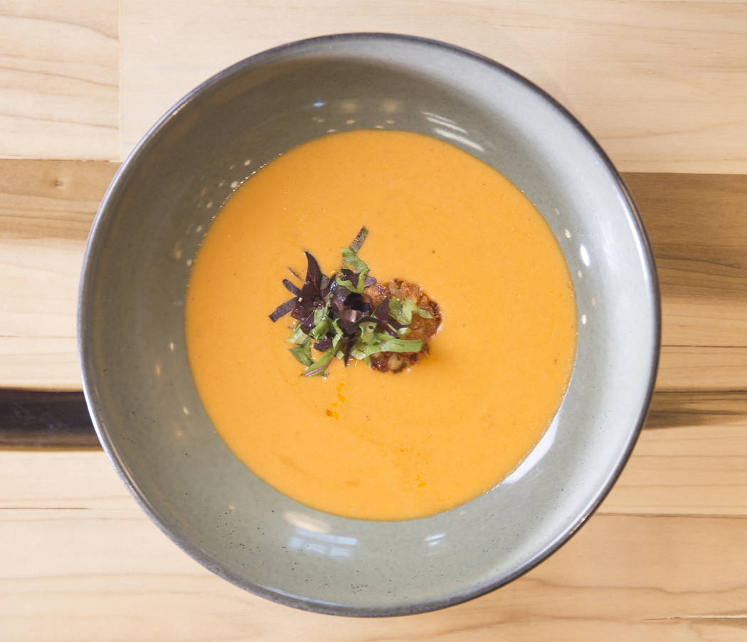 Crab bisque soup with dungeness crab, heavy cream, brandy and crab fritter at Kitchen Table Squared on Thursday, March 1, 2018, in Las Vegas. Benjamin Hager Las Vegas Review-Journal @benjaminhphoto
