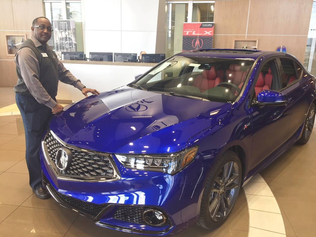 Findlay Acura Findlay Acura internet sales manager John Williams is seen with the 2018 TLX A-Spec in the showroom at 315 Auto Mall Drive in the Valley Automall. The dealership recently won its fif ...