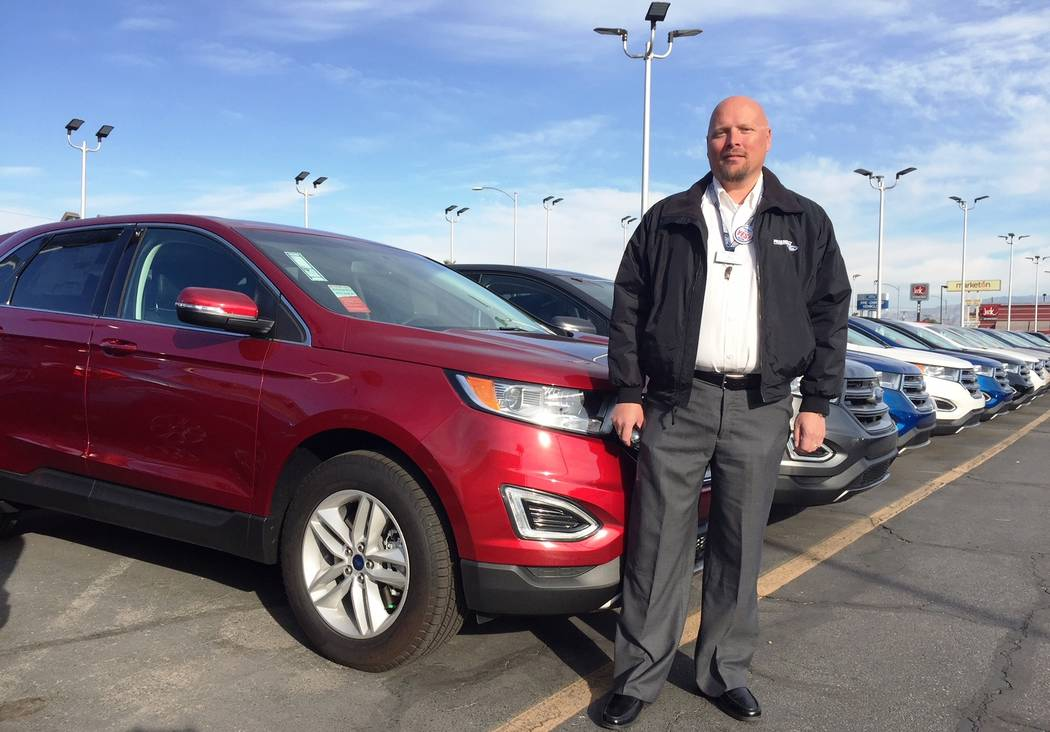 Friendly Ford Friendly Ford sales consultant Jake Linnell shows off 2018 Edge sport utility vehicles at the dealership located at 660 N. Decatur Blvd.