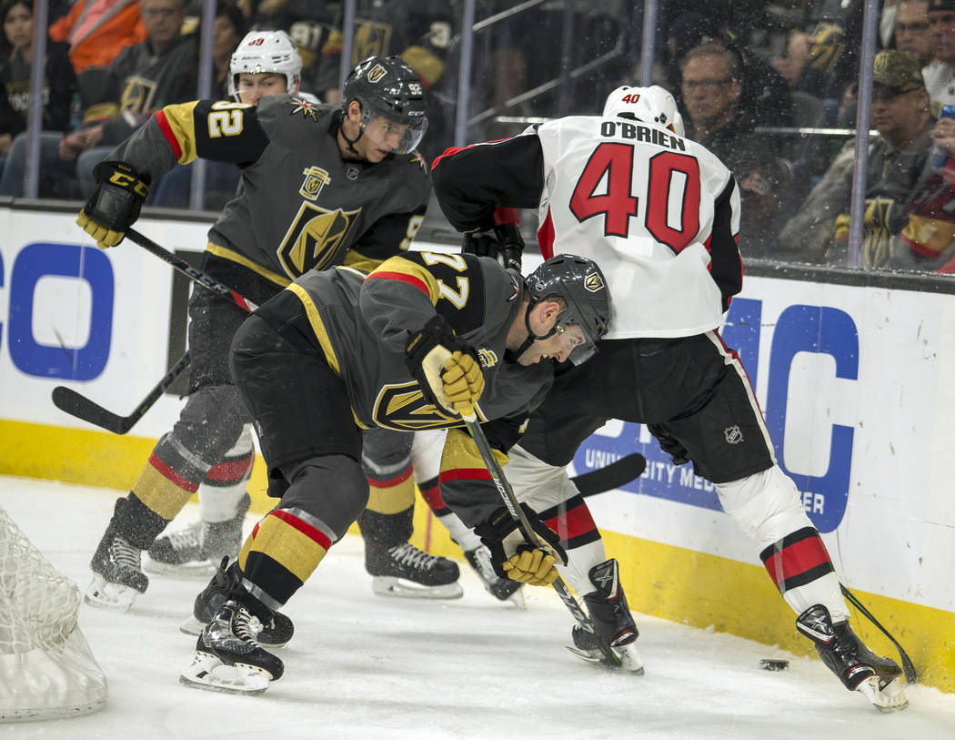 Vegas Golden Knights defenseman Brad Hunt (77) battles to get to the puck below Ottawa Senators center Jim O'Brien (40) during the first period of an NHL hockey game Friday, March 2, 2018, in Las  ...