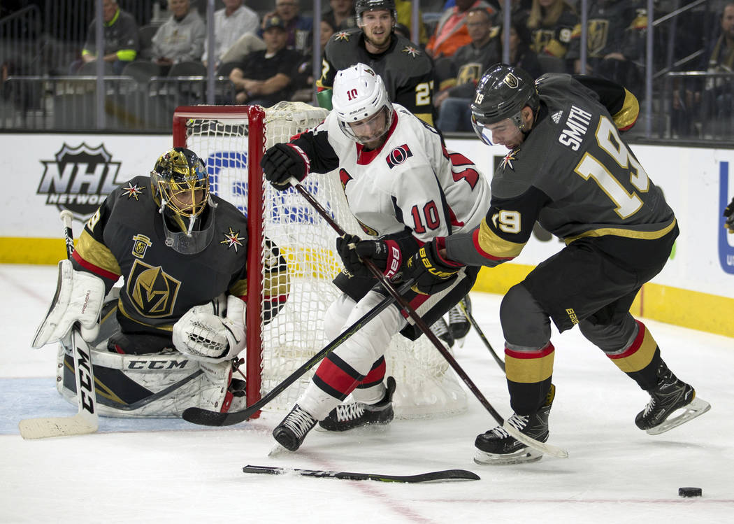 Ottawa Senators left wing Tom Pyatt (10) fights for control of the puck with Vegas Golden Knights right wing Reilly Smith (19) during the first period of an NHL hockey game Friday, March 2, 2018,  ...