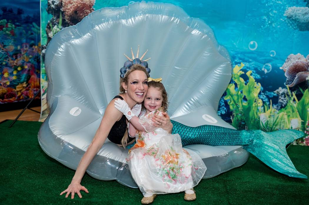 Credit: Joe Fury Farrah Sadighi poses for a photo with the Life Time Athletic Mermaid.