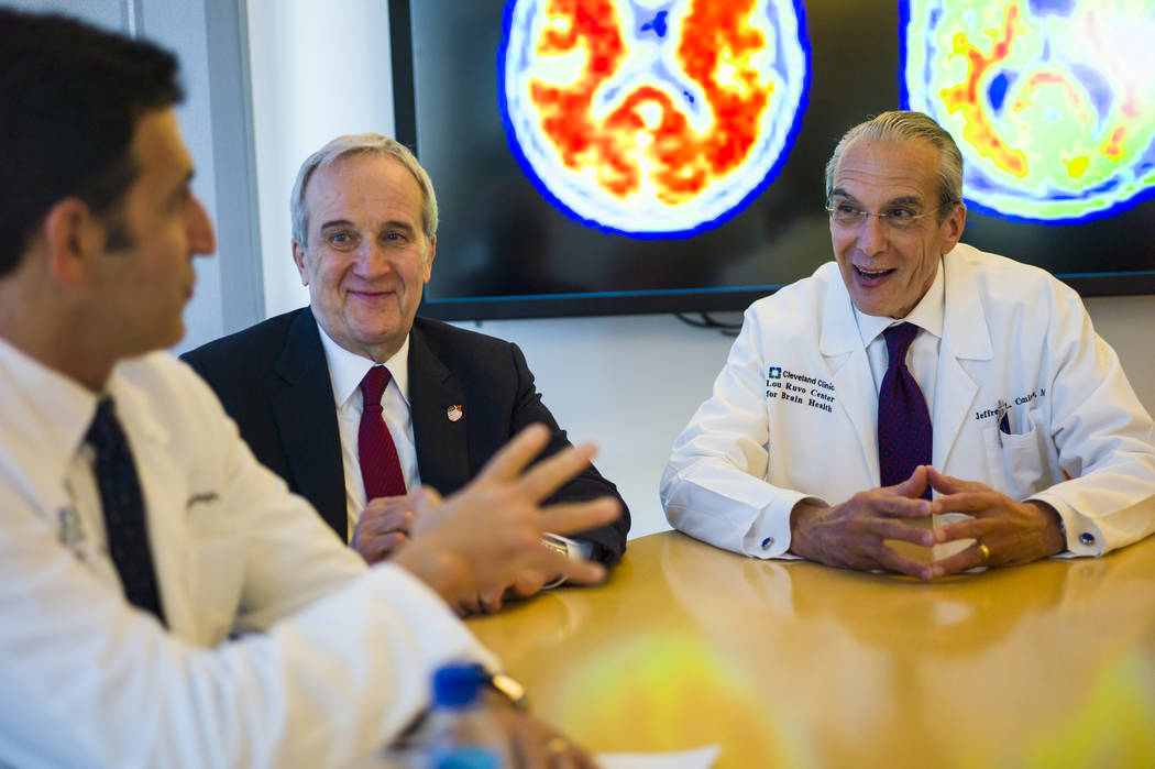 Dr. Marwan Sabbagh, who is taking over as the new director of the Cleveland Clinic Lou Ruvo Center for Brain Health, from left, talks with founder Larry Ruvo and current director Dr. Jeffrey Cummi ...