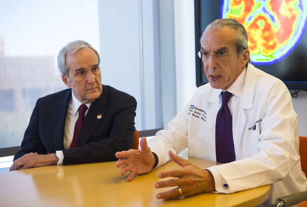 Dr. Jeffrey Cummings, outgoing director of the Cleveland Clinic Lou Ruvo Center for Brain Health, right, talks about the incoming director, Dr. Marwan Sabbagh, not pictured, next to Larry Ruvo, fo ...