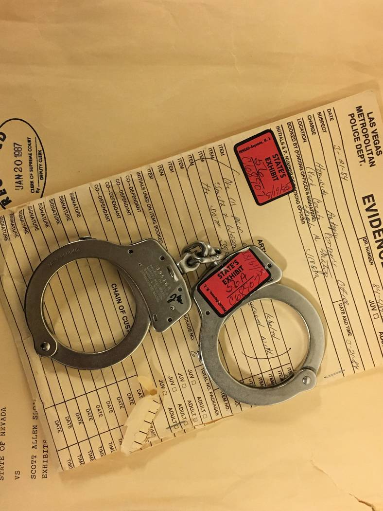 Handcuffs used in the slaying of Nancy Menke sit in an evidence vault at the Regional Justice Center. (David Ferrara/Las Vegas Review-Journal)