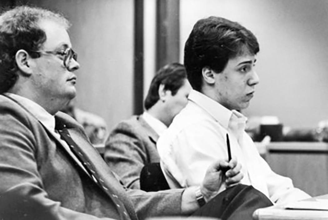 Scott Sloan, right, sits at a defense table in 1985 with his attorneys. Sloane was convicted of raping and murdering 41-year-old Nancy Menke. He has spent more than two decades behind bars. (Las V ...