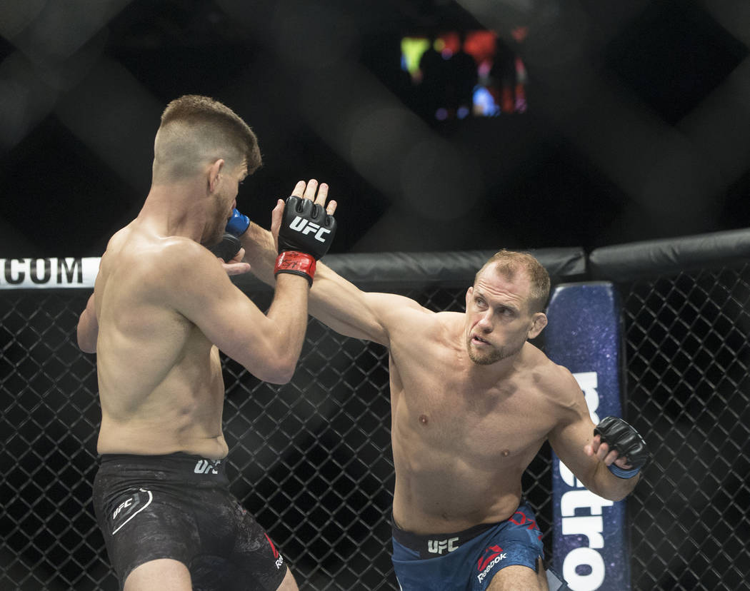 Zak Ottow, right, connects with a right hook against Mike Pyle during their welterweight matchup at UFC 222 at T-Mobile Arena on Saturday, March 3, 2018, in Las Vegas. Ottow beat Pyle via first ro ...
