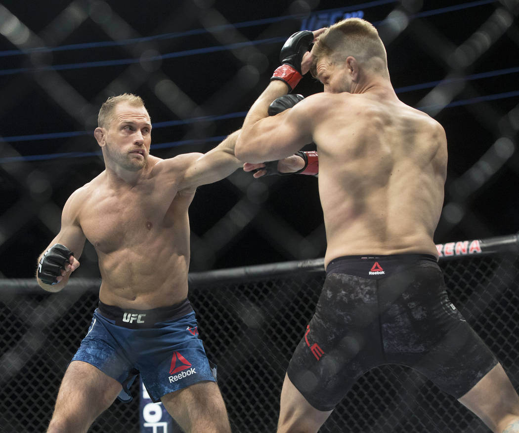 Zak Ottow, left, connects with a jab against Mike Pyle during their welterweight matchup at UFC 222 at T-Mobile Arena on Saturday, March 3, 2018, in Las Vegas. Ottow beat Pyle via first round stop ...