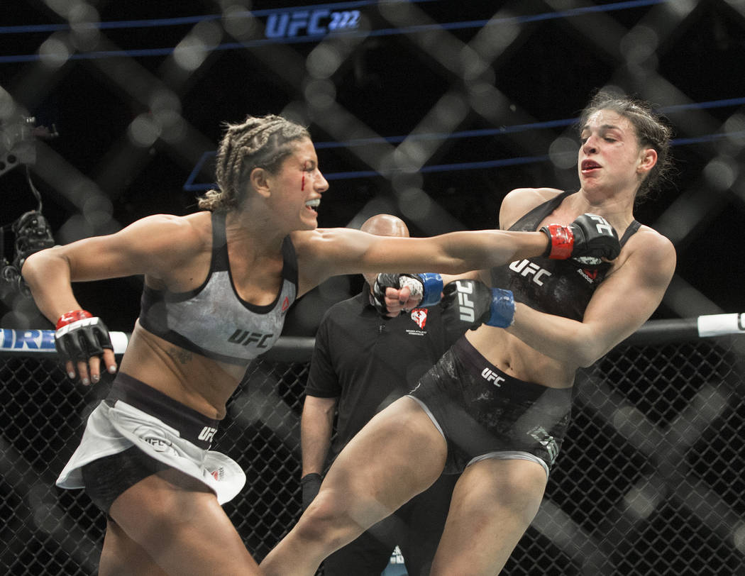 Ashley Yoder, left, connects with a jab against Mackenzie Dern during their strawweight matchup at UFC 222 at T-Mobile Arena on Saturday, March 3, 2018, in Las Vegas. Dern defeated Yoder by split  ...