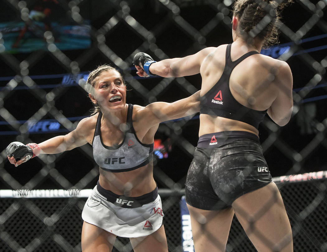 Ashley Yoder, left, connects with a left hook against Mackenzie Dern during their strawweight matchup at UFC 222 at T-Mobile Arena on Saturday, March 3, 2018, in Las Vegas. Dern defeated Yoder by  ...
