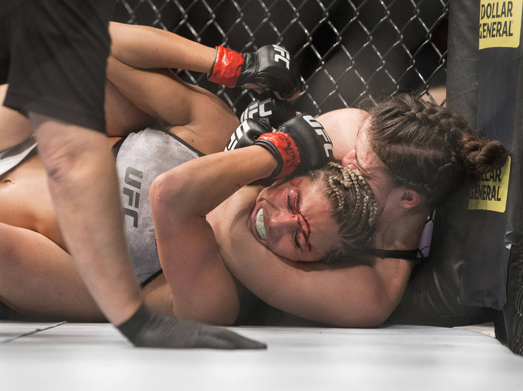 Mackenzie Dern, right, attempts to submit Ashley Yoder during their strawweight matchup at UFC 222 at T-Mobile Arena on Saturday, March 3, 2018, in Las Vegas. Dern defeated Yoder by split decision ...